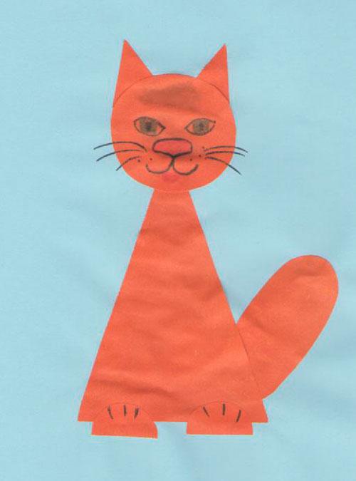 Оранжевая кошка на голубом фоне