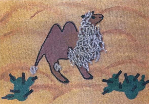 Приклеенный верблюд с пряжей на груди и голове