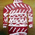 Рисунок: красный свитер с разными узорами