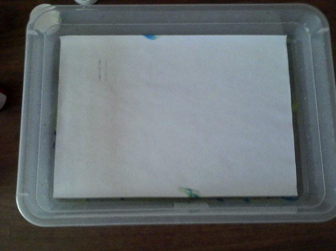 Изображение накрыто листом бумаги